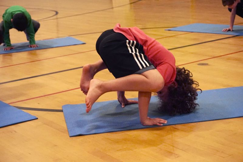 PMG PHOTO: CLAIRE HOLLEY - Hallinan student Sage Acosta has mastered crow pose.