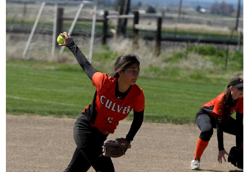 STEELE HAUGEN - Seirra Bautista pitched during the Lady Dawgs' 19-11 victory over Sheridan April 26.