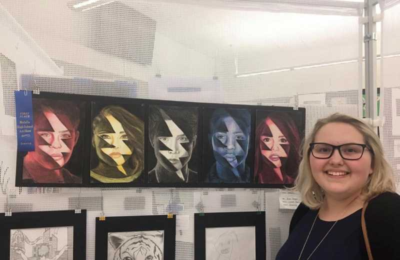 COURTESY PHOTO: MHS LEADERSHIP - MHS alumna Abby Beyer poses for a photo with her work at a previous showcase.