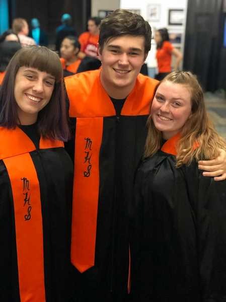COURTESY PHOTO: HEATHER WALBURN JONES - Three choir members pause for a photo. They are from left to right: Katelyn Streett, Ryan Kyllo and Grace Walburn Jones.