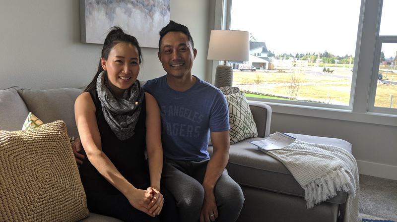 PAMPLIN MEDIA GROUP: JOSEPH GALLIVAN  - Mimi Kim (left) and her husband Joshua Kim came for a look-see. He's a dentist who dabbles in real estate sales for friends. It only took him a week to ace the realtors exam.