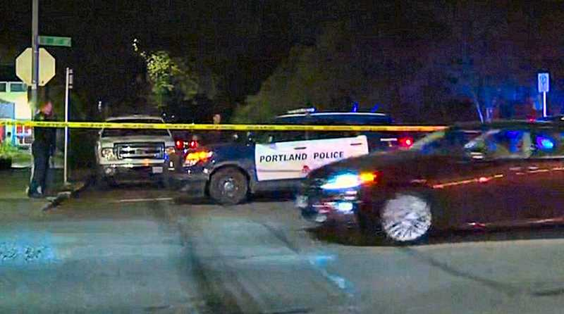 COURTESY OF KOIN-TV -6 NEWS - S.E. Umatilla was closed between 17th and 18th Avenues on Thursday night, May 2, to investigate an apparaent road rage shooting in Sellwood by a driver who fled the area. The victim was reportedly shot in the hip, and is expected to survive.