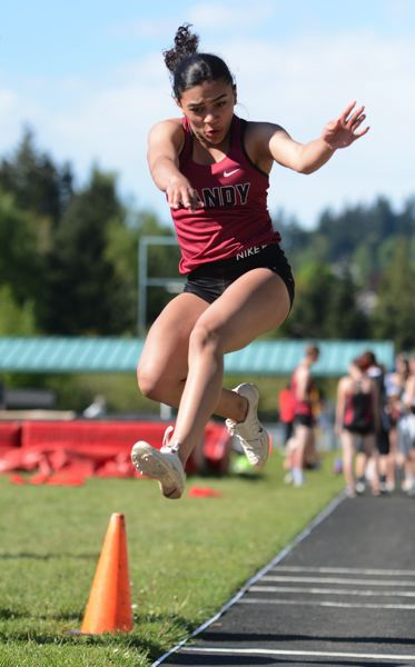 PMG PHOTO: DAVID BALL - Sandys Camille Walker puts down her landing gear on her way to a win in the long jump where she had the four best marks of the day.