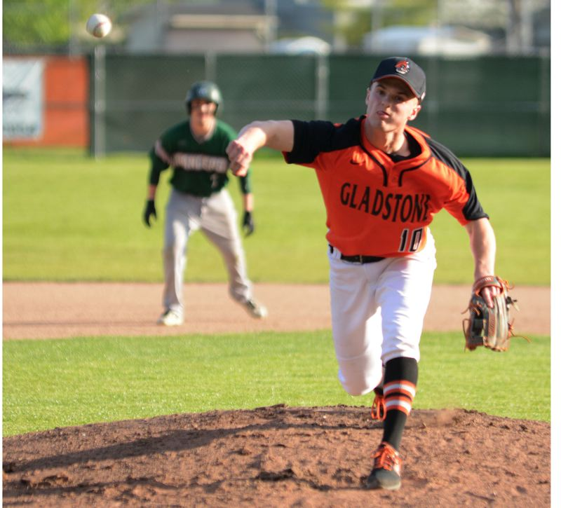 PMG PHOTO: DAVID BALL - Gladstone's Austin Conner fires a pitch during his seven-strikeout performance on Monday.