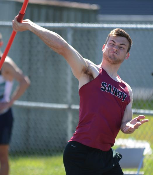 PMG PHOTO: DAVID BALL - Sandys Dallin Thomas lets loose with a throw on his way to a win in the javelin last week at Clackamas.
