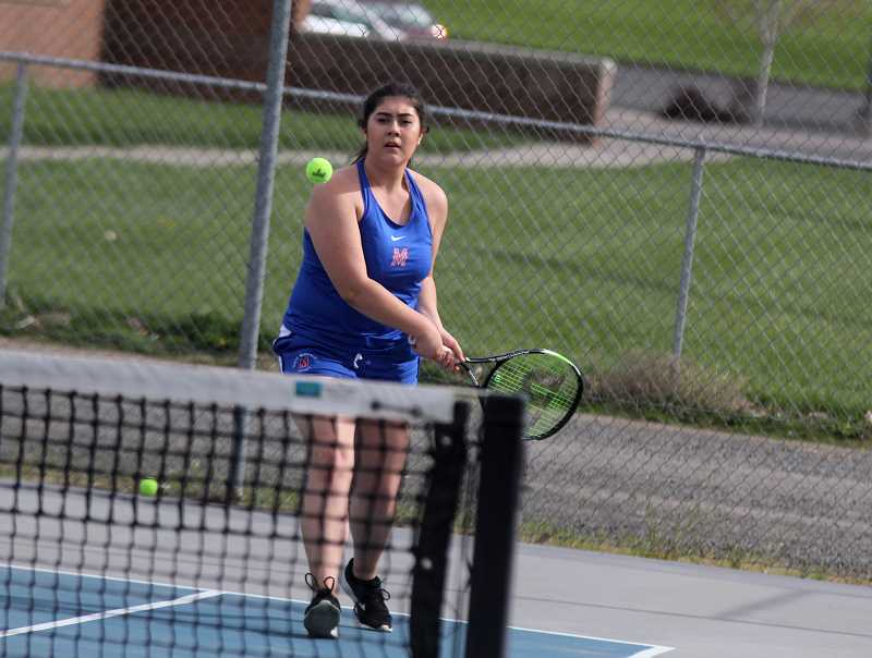STEELE HAUGEN - Senior Elaina Nambo was one of the six Madras girls tennis athletes to participate at their senior night meet April 25.