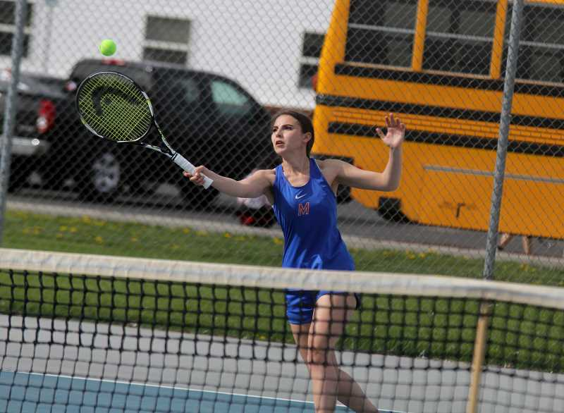 STEELE HAUGEN - Erica Desjardins returns the tennis ball at a meet against Philomath April 25.
