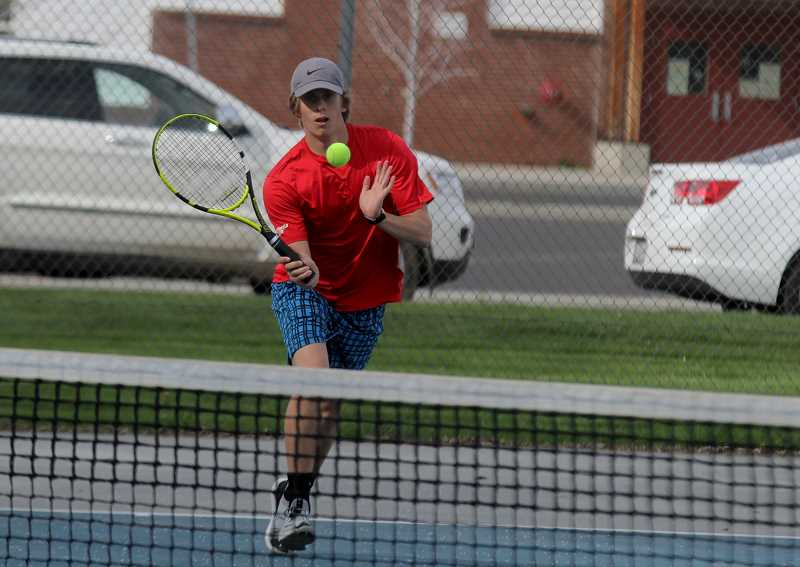 STEELE HAUGEN - Senior Coty Simmons focuses on the ball during a match against Woodburn April 23.