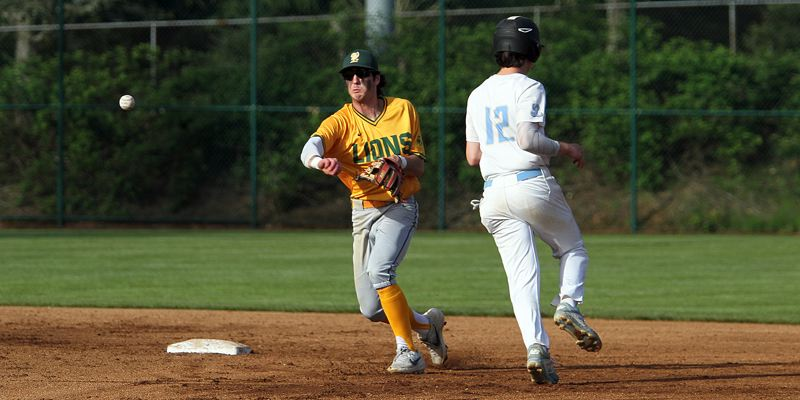PMG PHOTO: MILES VANCE - West Linn shortstop J.K. Kelly and the Lions lead the Three Rivers League but must beat Tigard today at 4:30 p.m. to avoid getting swept by the Tigers.