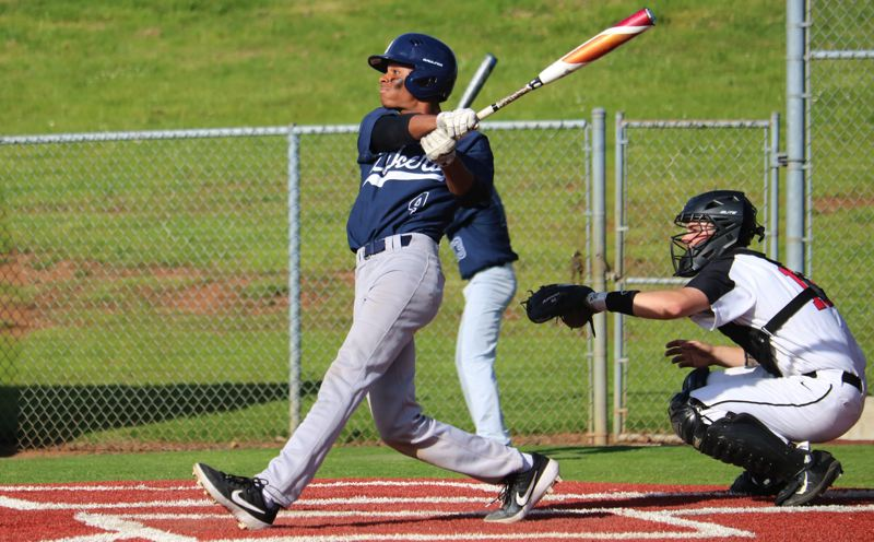 PMG PHOTO: JIM BESEDA - Lake Oswego's Malcolm Williams doubles during his team's 9-8 win over Oregon City on Wednesday, May 1, at Oregon City High School.