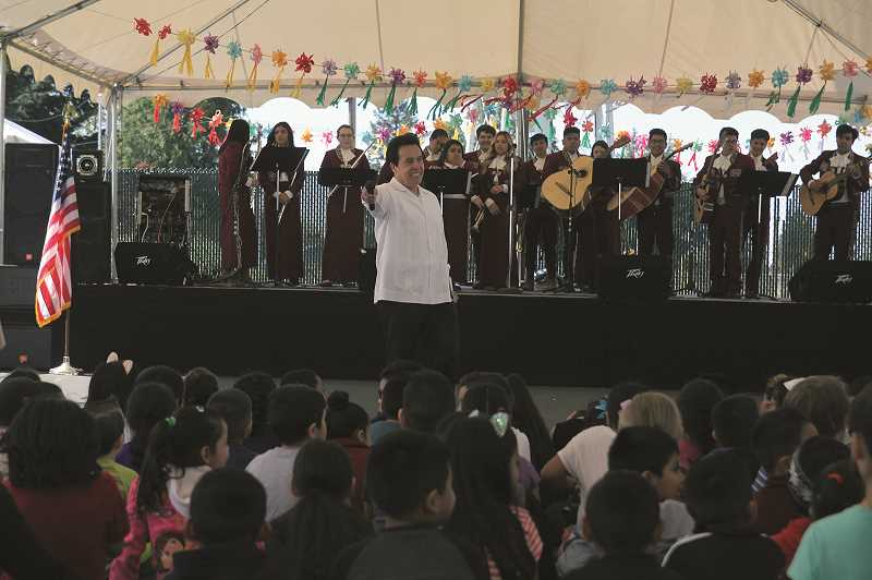 PMG PHOTO: PHIL HAWKINS - Elias Villegas, Dean of Woodburn Chemeketa Center, addresses a young audience during Woodburn's 14 annual Cinco de Mayo celebration hosted by Chemeketa Community College