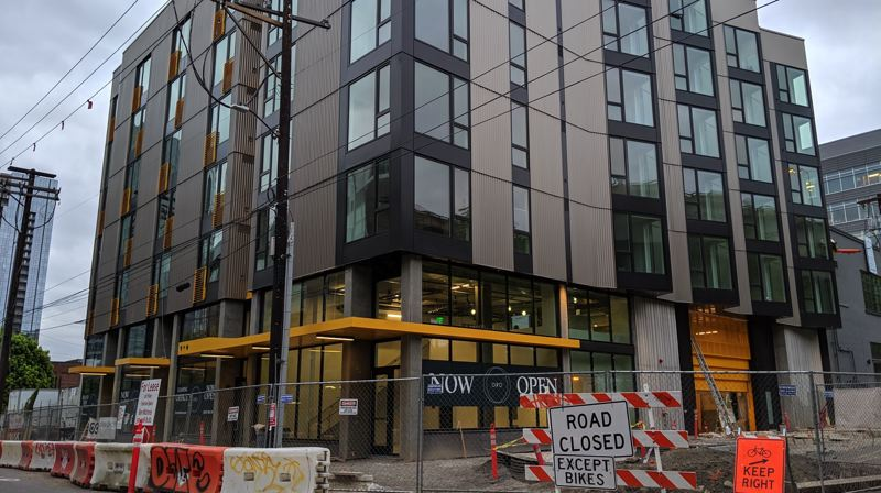 PMG PHOTO: JOSEPH GALLIVAN - The finishing touches are being put on the Oro apartments, which are anticipated to be filled by November, 2019. Yellow awnings mark the entrance on the cover of Overton and NW 15th.
