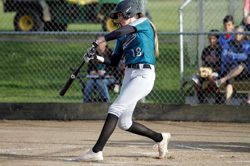 PMG PHOTO: WADE EVANSON - Century's Gavyn Shafer takes a cut during the Jaguars' game against Newberg Friday, May 3, at Century High School.