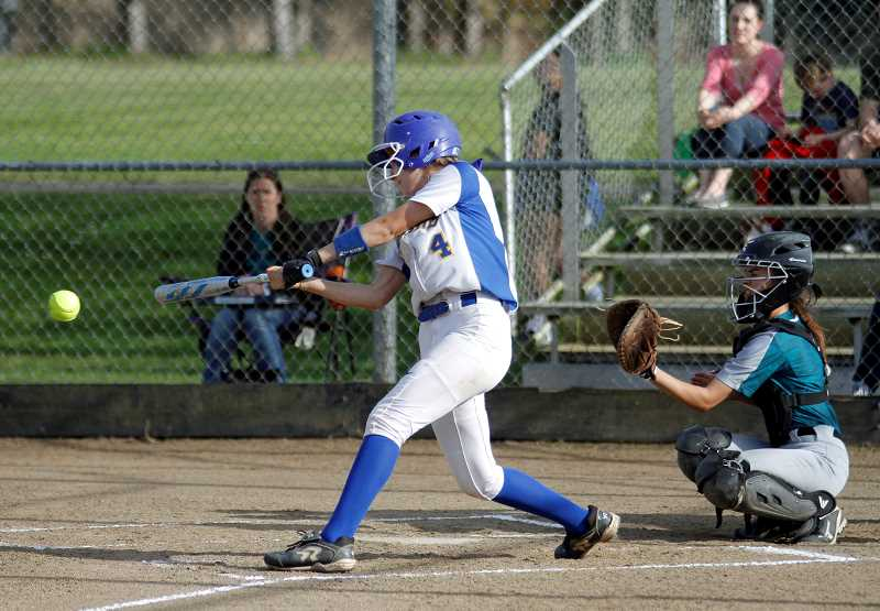 PMG PHOTO: WADE EVANSON - Newberg's Brooke Poff takes a swing during the Tigers' game versus Century Friday, May 3, at Century High School.
