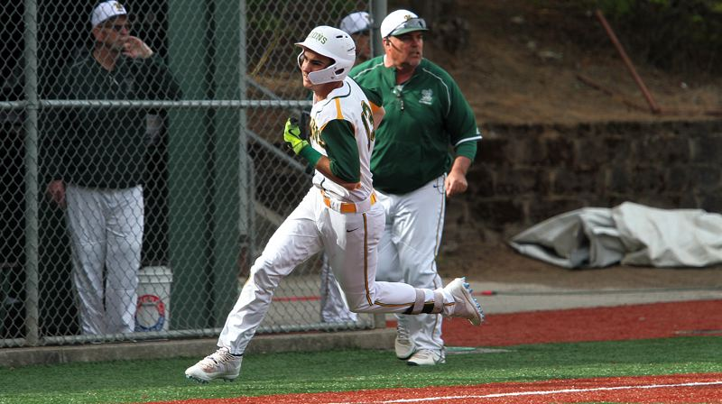 PMG PHOTO: MILES VANCE - West Linn senior J.K. Kelly races around third base on his way to an inside-the-park grand slam home run in his team's 4-2 win over Tigard at West Linn High School on Fridat, May 3.
