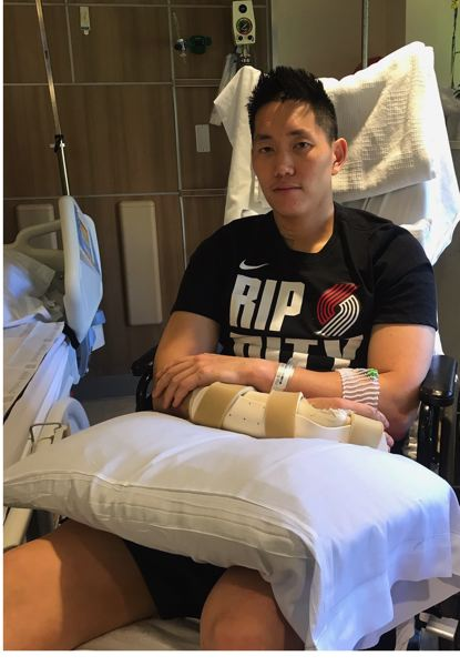 PMG PHOTO: KERRY EGGERS - Jonathan Yim, video coordinator and player development coach for the Trail Blazers, says the support he's received from the organization and even fans he doesn't know has been  'overwhelming' since he and three family members were hurt in an April 24 car crash.