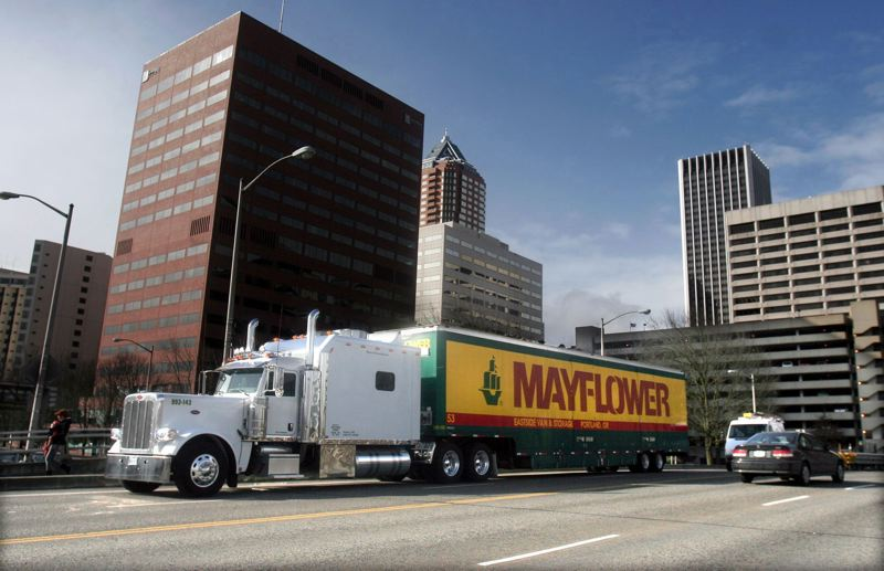 FILE PHOTO - A Mayflower Moving truck pulls up onto the Hawthorne bridge in Southwest Portland.