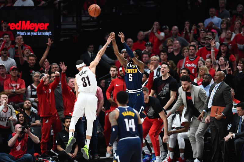 PMG PHOTO: CHRISTOPHER OERTELL - Seth Curry of the Trail Blazers contests a 3-pointer by Will Barton of the Denver Nuggets during Game 4 of their NBA playoff series Sunday at Moda Center.