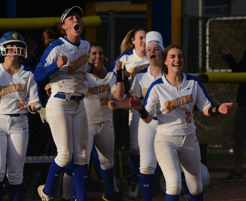 PMG PHOTO: DAVID BALL - Barlow players pour out of the dugout after an overthrow at first base allowed Chloe Hilstenteger to score the winning run in the bottom of the seventh inning.