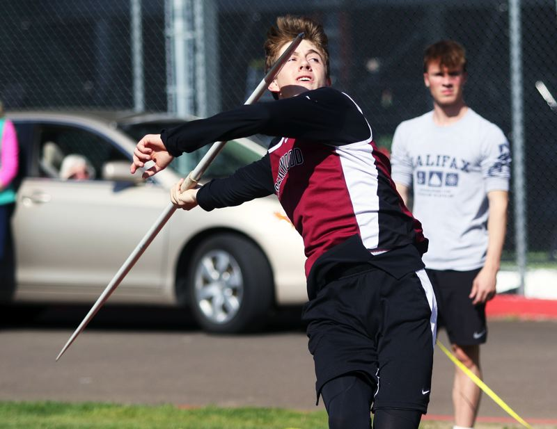 PMG PHOTO: DAN BROOD - Sherwood High School sophomore Asher Krauel took first place in the javelin event during the dual meet with McMinnville with a personal-best throw of 186 feet, 8 inches.