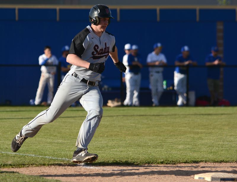 PMG PHOTO: DAVID BALL - Sandys Quinnton Reilly rounds first base with a hit during the Pioneers 10-2 loss in Game 2 of the series Thursday.