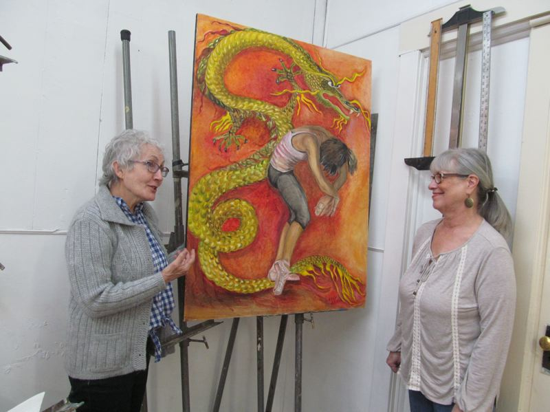 PHOTO BY ELLEN SPITALERI - Hedy Dykes, left, tells Karen Wackrow that she made the painting behind her to honor the Jefferson Dancers when they traveled to China.