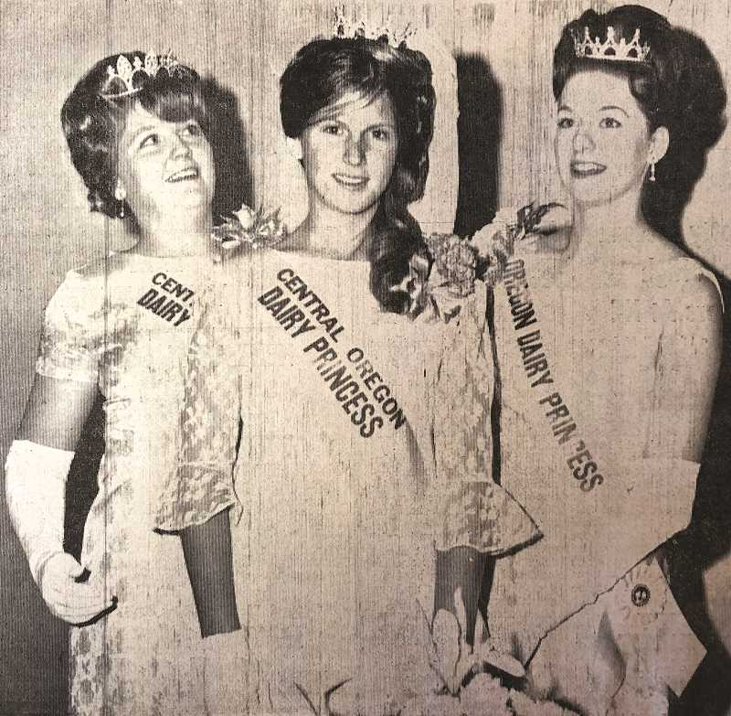 CENTRAL OREGONIAN FILE PHOTO  - MAY 8, 1969: MISS CATHY RACHOR, 17, daughter of Mr. and Mrs. Nick Rachor of Powell Butte was crowned Miss Central Oregon Dairy Princess of 1969 at the 10th Annual Central Oregon Dairy Princess Contest held at St. Thomas Parish Hall in Redmond. The contest-banquet is sponsored each year by Central Electric Cooperative. Shown to the left of Miss Rachor is last year's dairy princess, Miss Georganna Dowse of Redmond. At her right is Miss Melodee Purvis of Eugene, state dairy princess. Master of ceremonies for the evening of festivities was Bob Arnott of KRCO Radio. Miss Rachor received at $100 check to use toward her wardrobe for state competition.