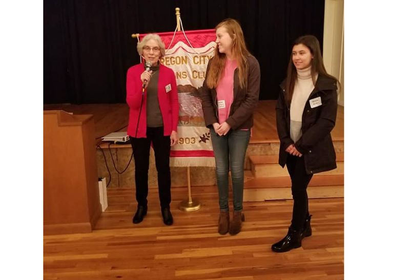SUBMITTED PHOTO - Alice Hayden, president of the Oregon City Woman's Club, introduces scholarship winners Sophia Youngblood and Keslie Keller at a recent club meeting.