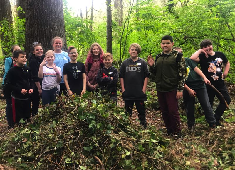 On Earth Day, Gladstone students removed invasive ivy in Mary S. Young State Park.