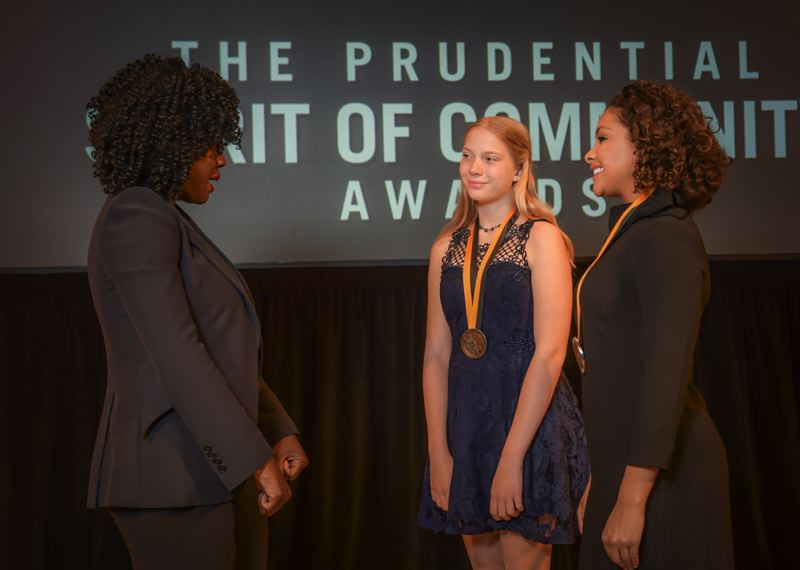 COURTESY PHOTO - From right Shayla Montgomery, 17, of Milwaukie and Jasmine White, 14, of Beaverton, meet award-winning actress Viola Davis at the Smithsonian's National Museum of Natural History.