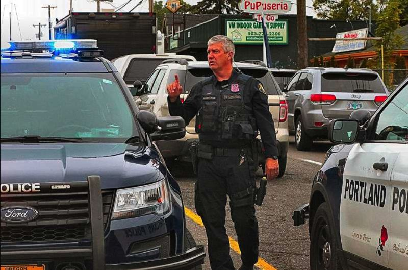 FILE PHOTO - Portland Police officers block off Southeast 82nd Avenue during a hostage situation at the Del Rancho motel.