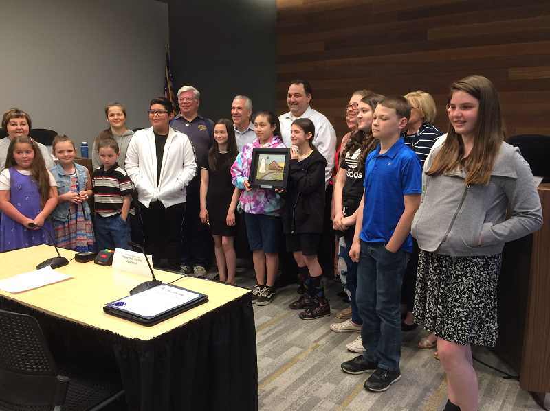 CAROL ROSEN - A group of people consisting of the HLC members, supporters and the and the planners of the Historic Walk joined students that contributed essays for the program gathered for a photo at the City Council meeting.