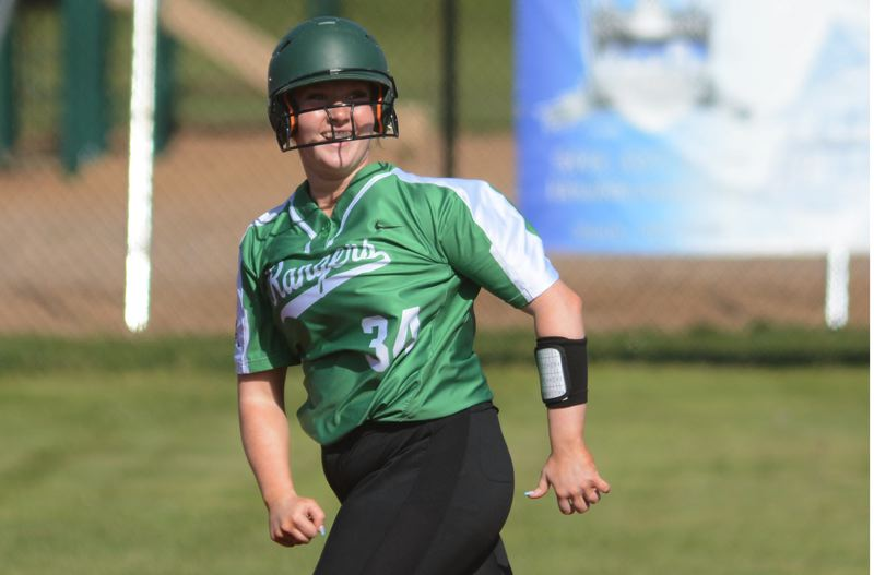 PMG PHOTO: DAVID BALL - Estacadas Rylie Canifax looks back to the bleachers to celebrate a first-inning home run.