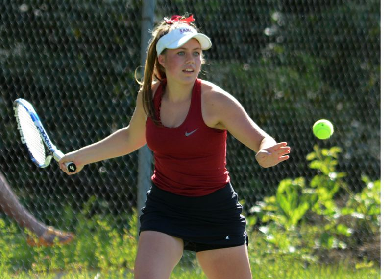 PMG PHOTO: DAVID BALL - Sandys Emma Donohue prepares to step into a forehand shot during a straight-set win with partner Kaitlyn Poulin in the first round of doubles.
