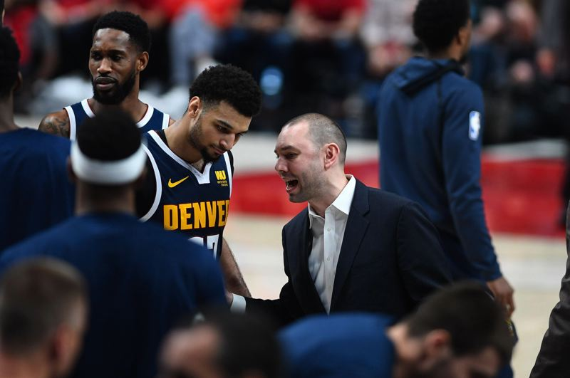 PMG PHOTO: CHRISTOPHER OERTELL - Denver assistant coach David Adelman, son of former Trail Blazers coach Rick Adelman, confers with Nuggets star Jamal Murray during Game 4 against Portland last week at Moda Center.