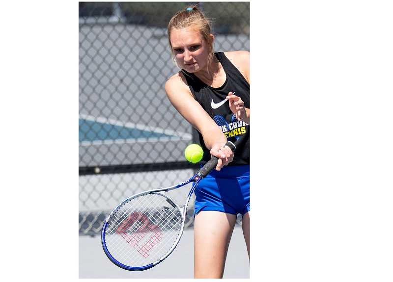 LON AUSTIN/CENTRAL OREGONIAN - Hannah Love plays a winning shot on Thursday against her opponent from The Dalles. Love won the No. 4 singles match 6-3, 6-2. The Cowgirls lost the dual 6-2 to the Riverhawks.