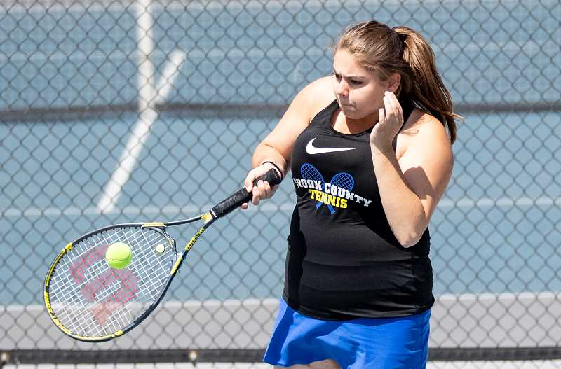 Katelynn Gibson plays a shot during a recent match. Gibson and her partner Alena McCabe lost a close match to Sylvie Heriza and Clare Durant of Pendleton on Saturday as the Buckaroos defeated the Cowgirls 5-3 in the final dual meet of the year for both teams.