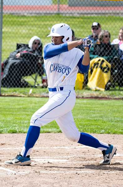 LON AUSTIN/CENTRAL OEGONIAN - Carson Smith had five hits on Friday as the Cowboys won both ends of a doubleheader from The Dalles.