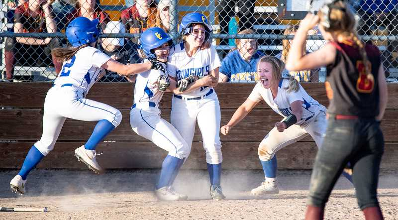 LON AUSTIN/CENTRAL OREGONIAN - (left to right) Mikinley Puckett, Berkley Puckett, Olivia Snoke and Ashley Owens celebrate after Owens and Snoke scored a pair of runs in the bottom half of the seventh inning to give the Cowgirls a 13-12 win over The Dalles. Allie Vaughan ripped a bases-loaded single to left center field, scoring the two runs and giving the Cowgirls their first league win of the season.