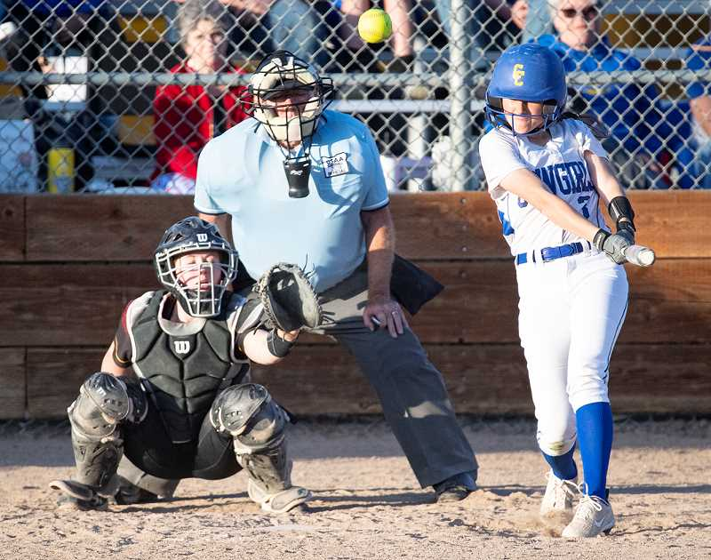 LON AUSTIN/CENTRAL OREGONIAN - Allie Vaughan rips her shot to right field that scored Owens and Snoke, giving the Cowgirls the come-from-behind win over the Riverhawks.
