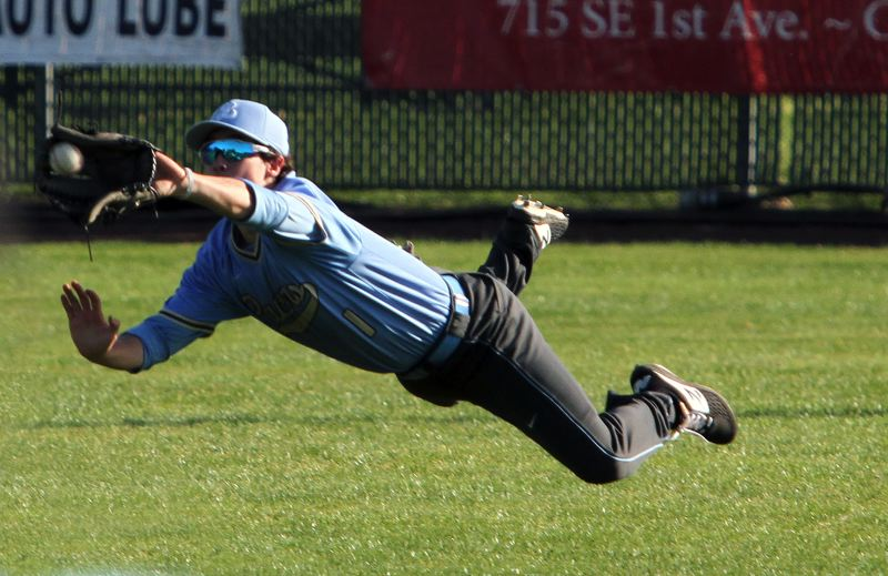 PMG PHOTO: MILES VANCE - Lakeridge center fielder Spencer Gore makes a diving catch during his team's 12-7 win at Canby on Thursday, May 2.