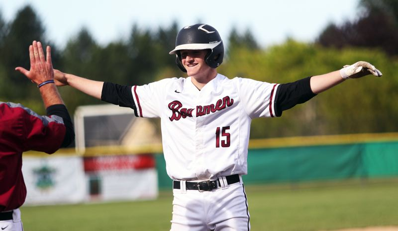 PMG PHOTO: DAN BROOD - Sherwood High School sophomore Jackson Hannan smiles after hitting a second-inning triple during the Bowmen's 10-0 win over Liberty.
