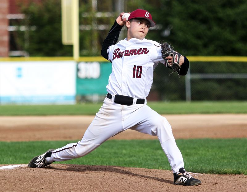 PMG PHOTO: DAN BROOD - Sherwood High School senior Anthony Garrett gets ready to fire a pitch to the plate during the Bowmen's 10-0 win over Liberty.