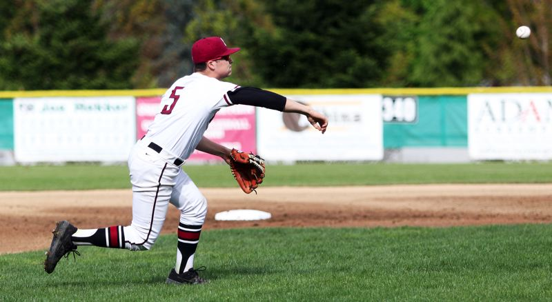 PMG PHOTO: DAN BROOD - Sherwood senior third baseman Christian Goyer makes a throw to first base during the opening inning of the Bowmen's 10-0 win over Liberty.