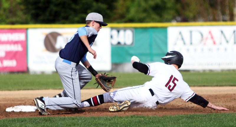 PMG PHOTO: DAN BROOD - Sherwood sophomore Jackson Hannan (15) slides safely to second base, as Libery junior shortstop Jacob Hoskins goes for the ball during the Bowmen's 10-0 win.
