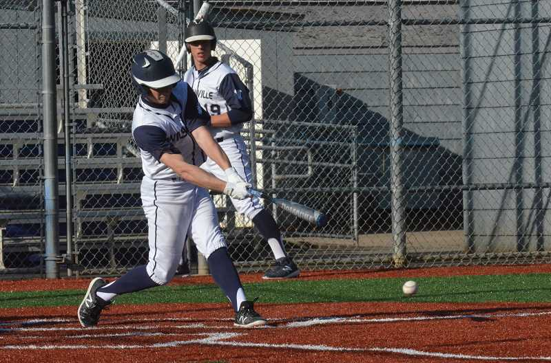 PMG PHOTO: TANNER RUSS - Junior Jarrod Seibel singles against Putnam.