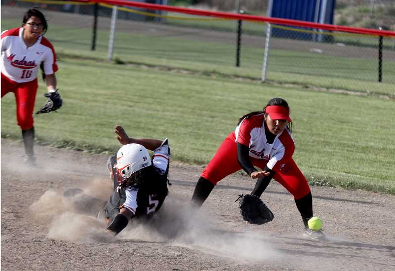STEELE HAUGEN - Junior Jiana Smith-Francis fields a low throw as a Gladstone runner slides into second base. The Buffalos lost to the Gladiators 5-4 in eight innings.