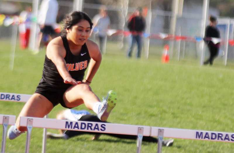 STEELE HAUGEN - Bridget Lopez places third in both the 100- and 300-meter hurdles at the Gilchrest Small School Invite May 4.