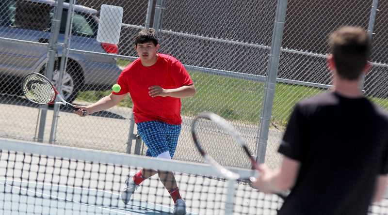STEELE HAUGEN -  Kahne Herkshan focuses on the ball during the first round of districts held in Madras May 2. Herkshan and doubles partner Byron Patt are playing in the consolation doubles bracket in the second round of districts at Black Butte Ranch in Sisters.