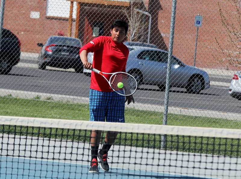 STEELE HAUGEN - Luis Mancera beats his Sisters opponent 6-7 (3), 6-2, 6-2, in the last regular season home match of the year April 29.